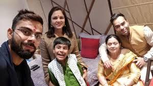 viratkohli with his family
