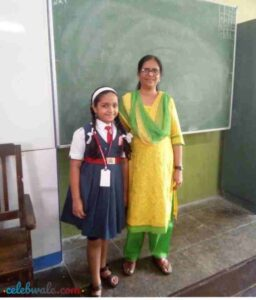 Aditi Jalatare with her school teacher