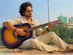 Harsh Rajput playing guitar