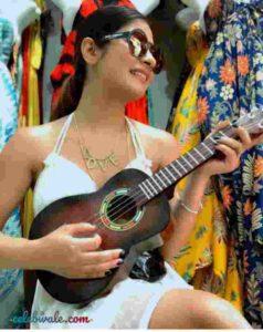 krishna mukherjee playing guitar