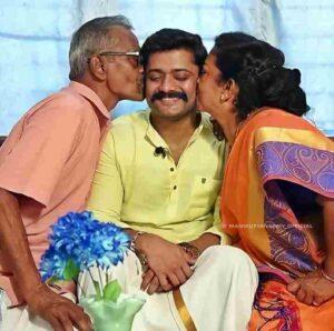 Manikuttan with his parents photos