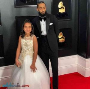 Nipsey Hussle with her daughter