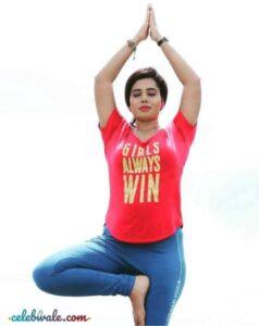 Remya Panicker doing yoga