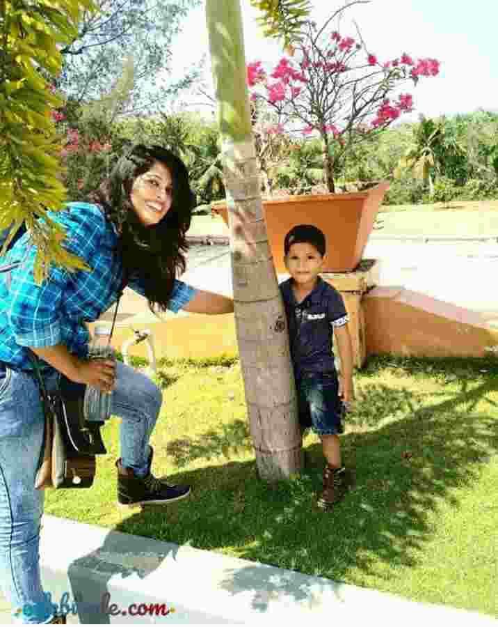 Sajina Firoz Khan with his son