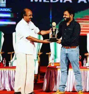 Kidilam Firoz receiving awards