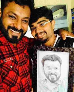 Kidilam Firoz with his fan